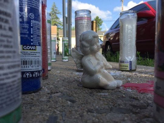 An angel figurine among candles placed at Smyser and North Penn streets for homicide victim L.A. Rasul Truvillion, 23, of York.