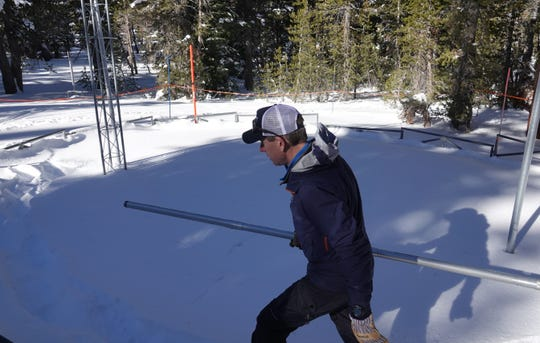 Hydrologist Jeff Anderson of the Natural Resources Conservation Service prepares to use a large, aluminum tube to measure the snowpack on Slide Mountain near Reno on Jan. 2, 2019.