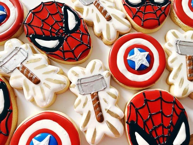 Custom-made sugar cookies by Gigglebox Sweets & Treats reflect a superhero theme.