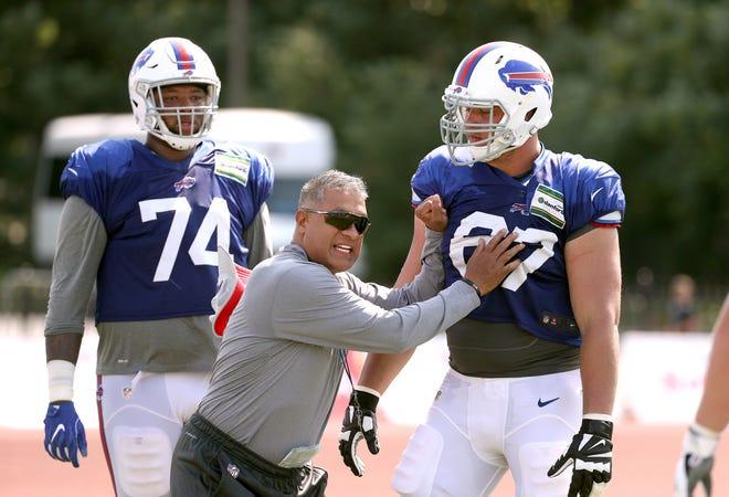 Bills offensive line coach Juan Castillo works on technique during training camp.
