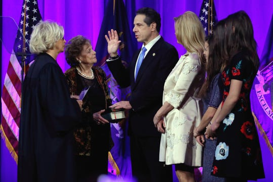 New York Gov. Andrew Cuomo takes his third oath of office, on Ellis Island in New York harbor, Tuesday, Jan. 1, 2019.