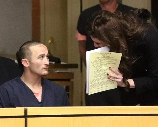 Attempted murder suspect Dillion Sullivan, left, appears with Senior Deputy Public Defender Ashley Jones in January in Shasta County Superior Court. Sullivan pleaded not guilty to 25 criminal counts that allege, among other crimes, attempted murder of three police officers and the shooting a police K-9 in the ear.
