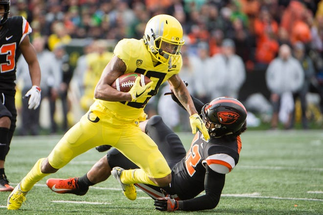 Nov 23, 2018; Corvallis, OR, USA; Oregon Ducks wide receiver Dillon Mitchell (13) catches a pass for a first down during the first half against the Oregon State Beavers at Reser Stadium. The Oregon Ducks beat the Oregon State Beavers 55-15. Mandatory Credit: Troy Wayrynen-USA TODAY Sports