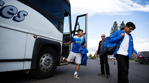McKay soccer players exit a bus.