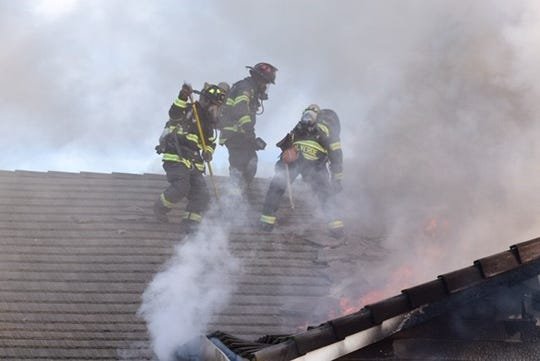 Firefighters battle a fire that damaged a home on New Year's Day in Salinas.