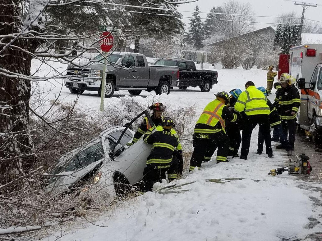 A women was transported to the hospital after her car slid off Mill Road and hit a tree, Wednesday, January 2, 2019, in Sheboygan, Wis.