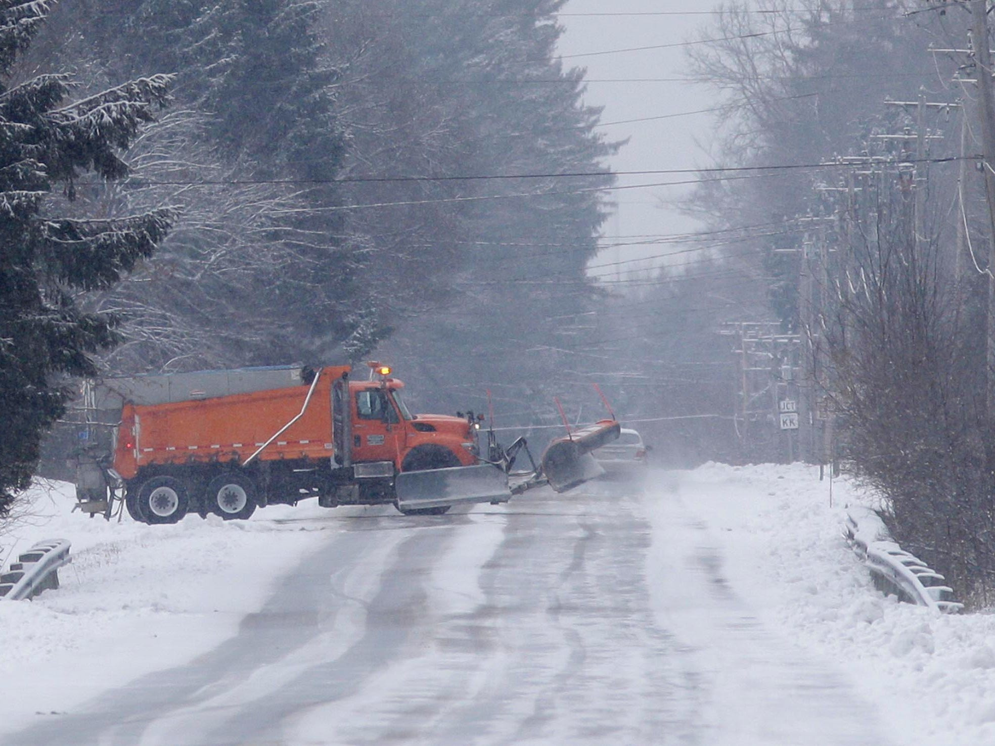 A snow plow turns around on South 12th Street, Wednesday, January 2, 2019, in Sheboygan, Wis.