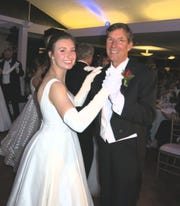 Debutante Lilly Huggs and her father, Gerald E. Huggs Jr. ,    dance after the formal presentation.