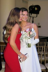 Debutante Grace Poimboeuf (right) and a friend at Debutante Ball.