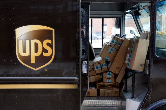 Packages await delivery inside of a UPS truck in Baltimore.