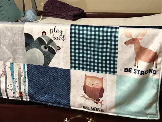 A blanket made for Royce Merrigan by a family friend.