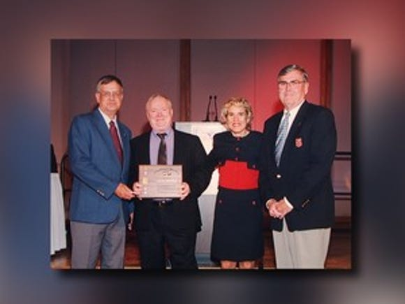In 1999, Kapitan received the National Distinguished Official Award from the National Federation Interscholastic Officials Association at a banquet in Kansas City, Mo.