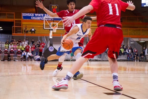 Red Cloud's Alejandro Rama drives towards the basket during the 2018 Class A state tournament.