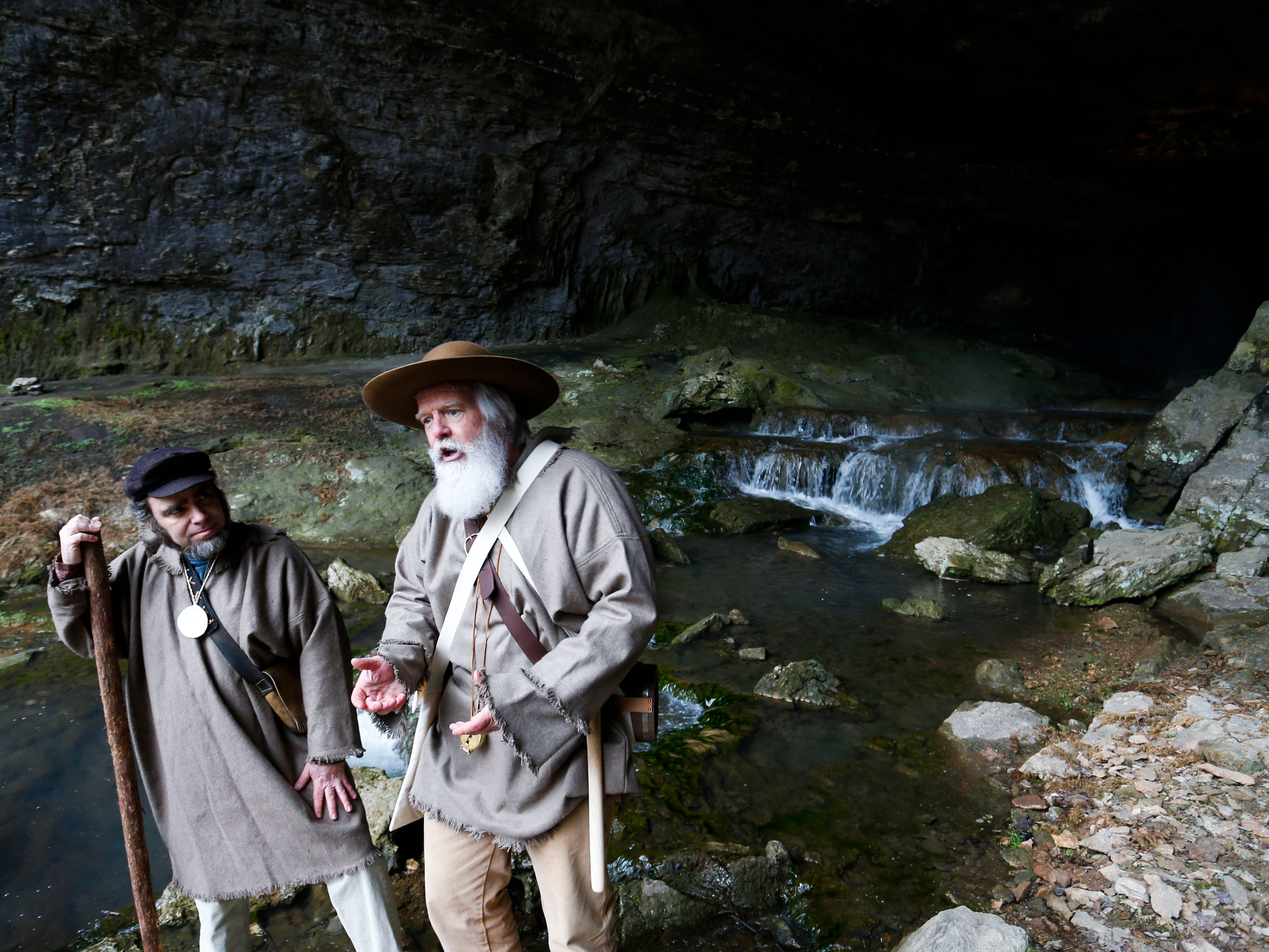 Rick Mansfield, right, talks about re-creating Henry Rowe Schoolcraft's 900-mile trek through the Ozarks at Smallin Civil War Cave on Wednesday, Jan. 2, 2019, almost 200 years to the day that Schoolcraft visited the cave. Eric Fuller, left, portrays Schoolcraft's companion on the trek, Levi Pettibone.