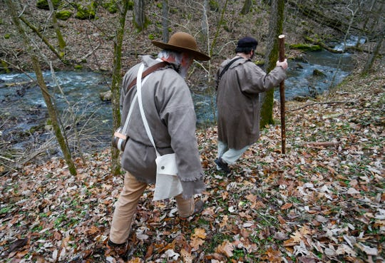 Rick Mansfield, left, and Eric Fuller trek along a creek leading out of Smallin Civil War Cave on Wednesday, Jan. 2, 2019, almost 200 years to the day that Henry Rowe Schoolcraft visited the cave on his 900-mile trek through the Ozarks.