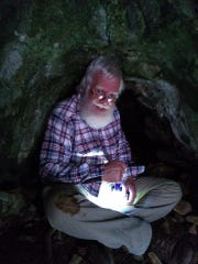 Rick Mansfield holing up for the night in a cave along the route that Henry Schoolcraft trekked 200 years ago.