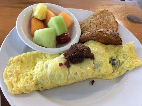 A Mediterranean omelet is among the breakfast and lunch treats on the menu at the new Grove Market Cafe in the Northeast, from David and Elizabeth Gwynn, owners of Cypress Restaurant.