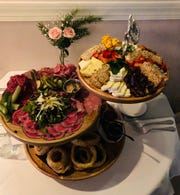 It's a combination of three appetizers, a charcuterie board,beef tenderloin carpaccio and onion rings.