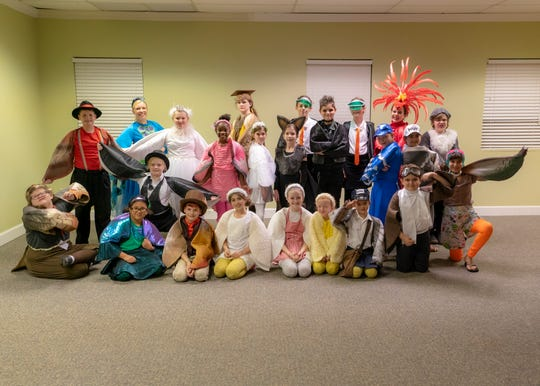"The costumed cast of ""Under The Rainbow."""
