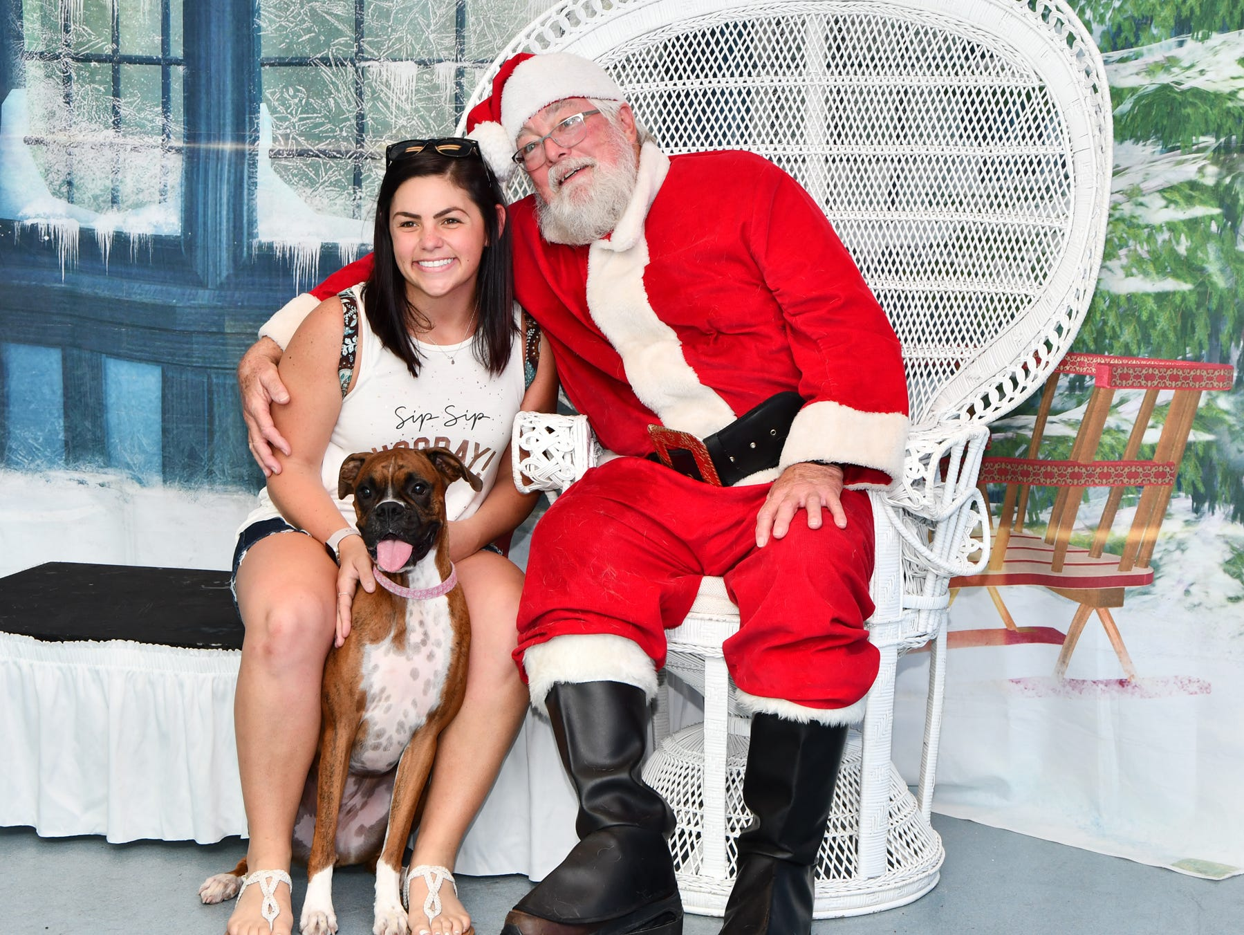 Samantha Garber and her dog Callie pose for a picture with Santa at the Pooch Plunge at Sailfish Splash Waterpark.