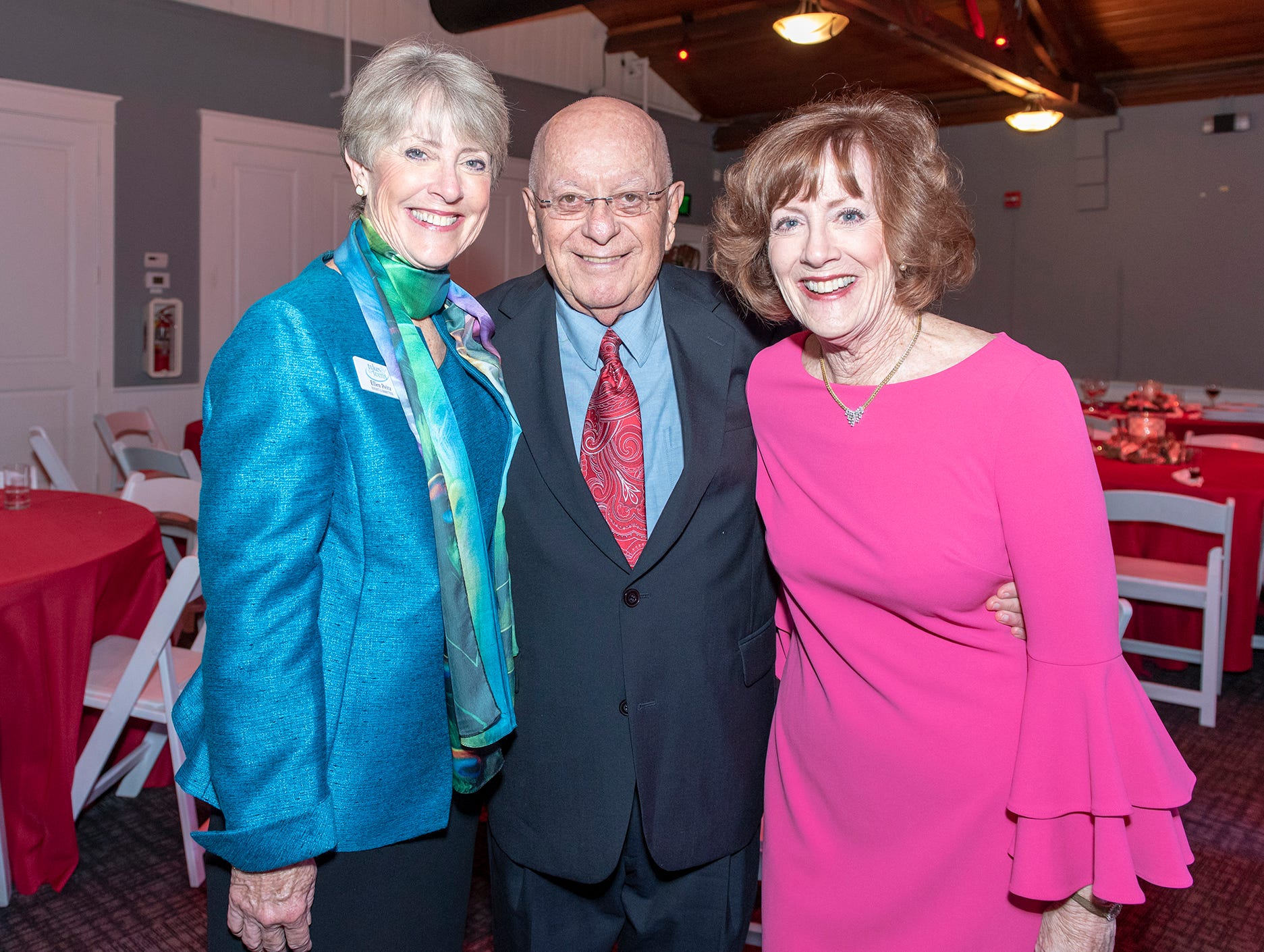 Ellen Peitz, left, Dr. Howard Voss and Joanne Kelly at the Tykes & Teens Festival of Trees & Lights.