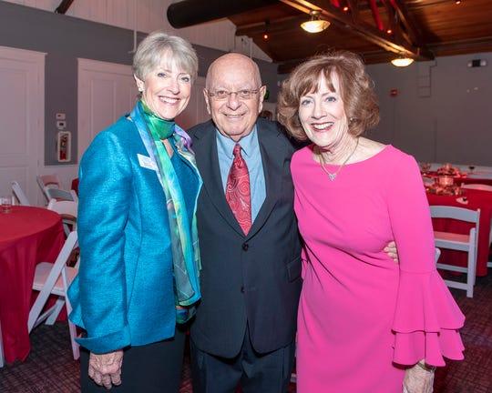 Ellen Peitz, left, Dr. Howard Voss and Joanne Kelly at the Tykes & Teens Festival of Trees & Lights.