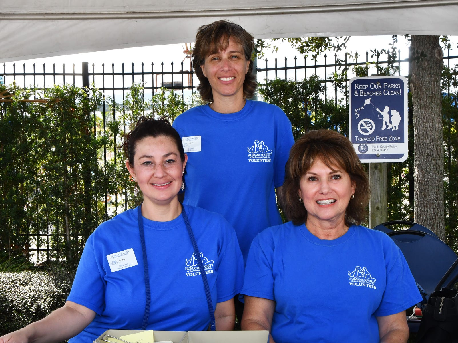 Humane Society of the Treasure Coast volunteers Gina Tapias, left, Bari Wasserman and Margie Jones at the Santa Paws Holiday Pooch Plunge at Sailfish Splash Waterpark.