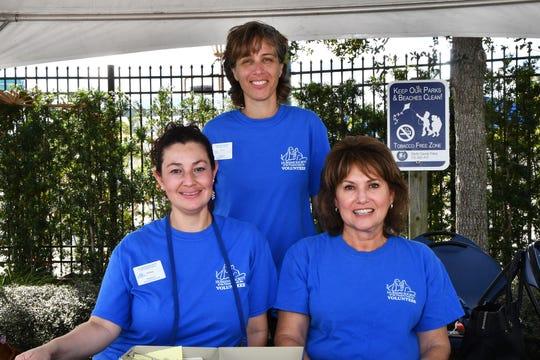 Humane Society of the Treasure Coast volunteers Gina Tapias, left, Bari Wasserman and Margie Jones at the Santa Paws Holiday Pooch Plunge at Sailfish Splash Waterpark.