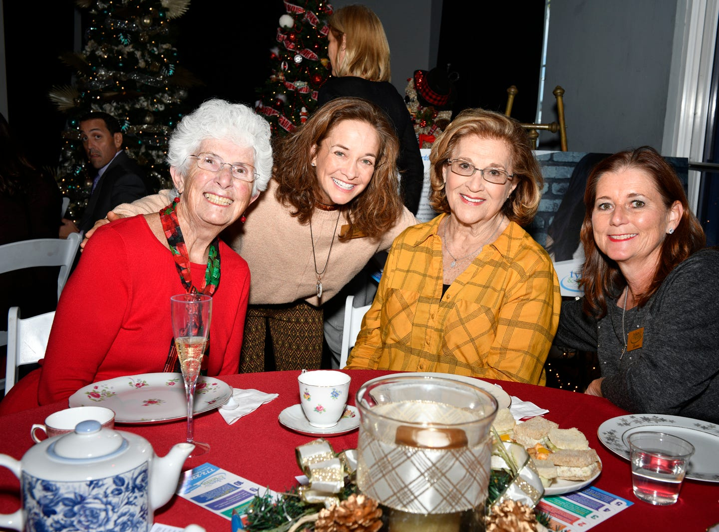 Jane Buss, left, Debbie Maunus, Nancy Marin and Sue Whittington at the Tykes & Teens Festival of Trees & Lights' Afternoon Champagne Tea.