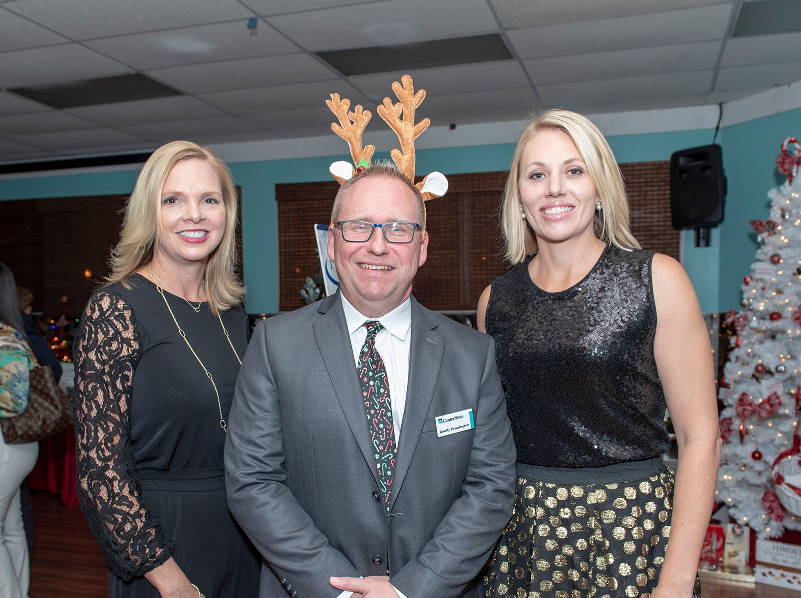 Christine DelVecchio, left, Randy Pennington and Kelly Johnson at the Tykes & Teens Festival of Trees & Lights.