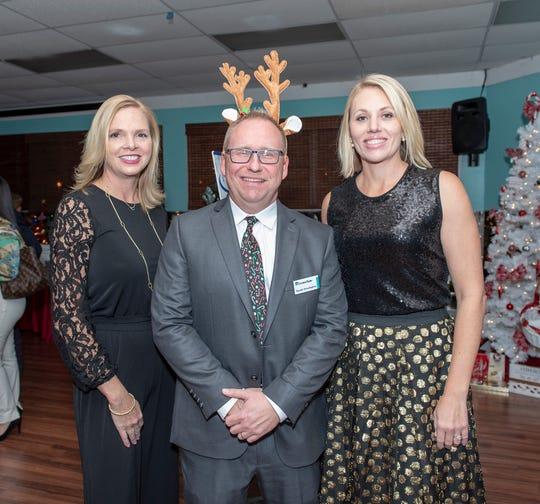 Christine DelVecchio, left, Randy Pennington and Kelly Johnson at the Tykes & Teens Festival of Trees & Lights.