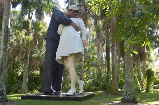 """Twenty life-scale bronze figures from Johnson's """"Celebrating the Familiar"""" series, along with the """"Embracing Peace"""" bronze sculpture already on display, are placed throughout McKee Botanical Garden, 350 U.S. 1 in Vero Beach, on April 28, 2019. The garden will host a """"kiss-in"""" on Valentine's Day."""