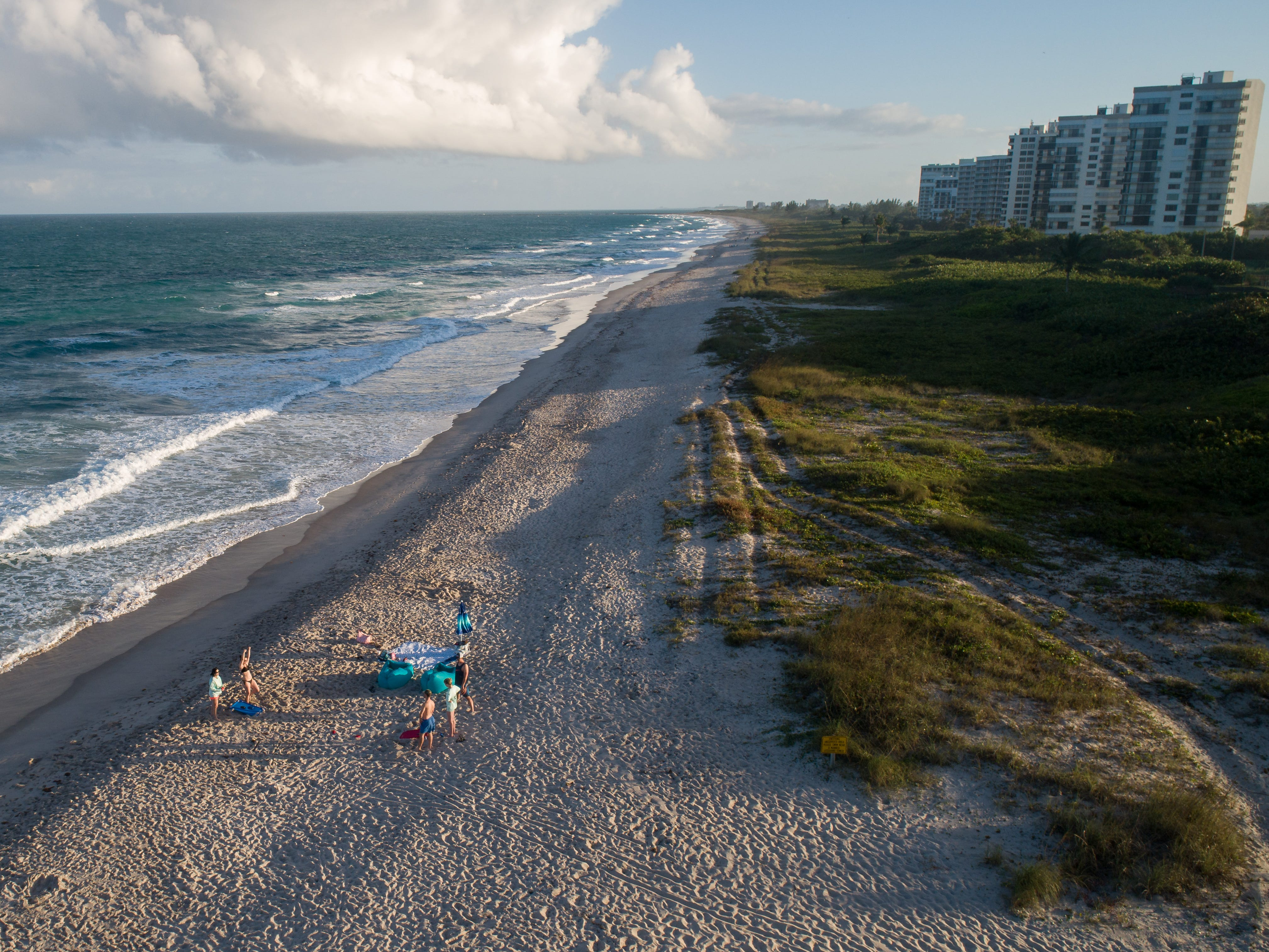 Few people are seen out at Pepper Park Beachside shortly before the sun sets on the last day of the year Monday, Dec. 31, 2018, in St. Lucie County. Beach access was closed earlier in the year due to red tide.