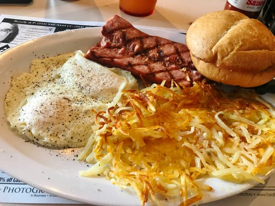 Over easy eggs, kielbasa, hash brownsand a Kaiser roll from Rick's Diner in Port St. Lucie.