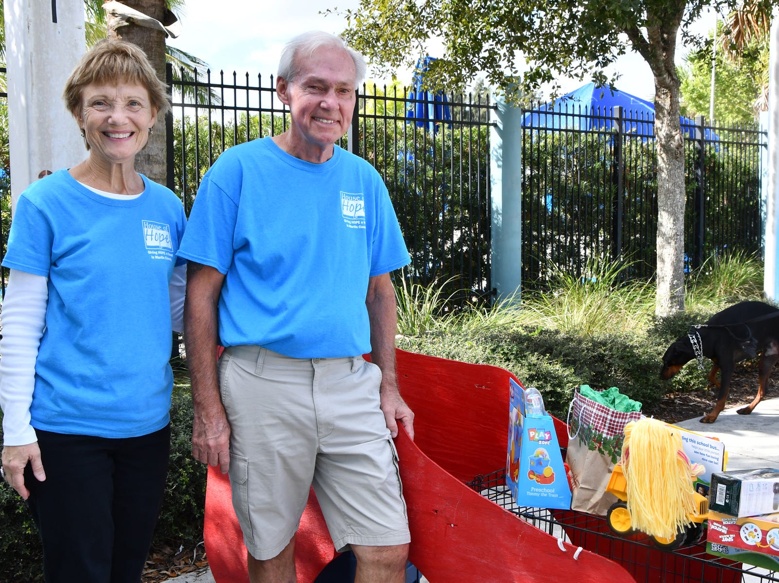 House of Hope volunteers Karl and Diane Lehtola collected unwrapped toys for needy children at the Pooch Plunge at Sailfish Splash Waterpark.