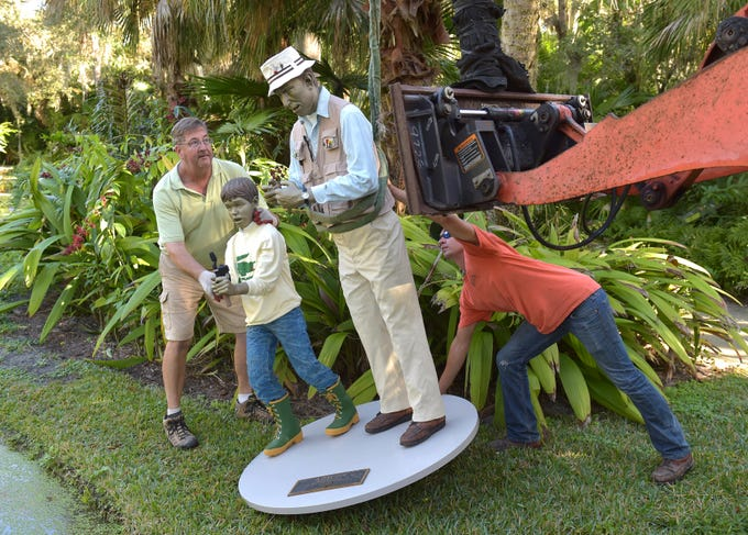 "Andreas Daehnick (left), director of horticulture at McKee Botanical Garden, and Zachary Metz, of Florida Native Landscapes, place the sculpture titled A Day Off, along the edge of a pond on Wednesday, Jan. 2, 2019, during the installation of the Seward Johnson sculpture exhibition inside the garden at McKee, 350 US Highway 1, south of Vero Beach in Indian River County. ""I enjoy it, trying to make it realistic and meet and exceed people's expectations for the presentation, it's fun,"" Daehnick said while helping position the pieces. Twenty life-scale bronze figures from Seward Johnson's Celebrating the Familiar series, along with the Embracing Peace bronze sculpture already on display, are placed throughout the garden through April 28, 2019. ""This is the most asked about exhibition from our visitors, and so we decided to bring it back,"" said Christine Hobart, executive director at McKee.  ""I think it appeals to people because they are so life-like, and you don't really know if they are sculpture, or worker, or person doing whatever the action is."""