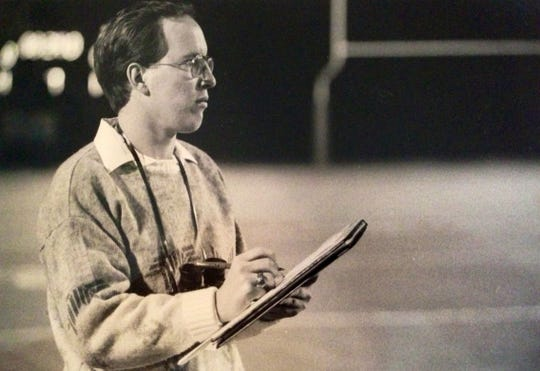 TCPalm's Dennis Jacob covers a high school football game in the late 1980s.
