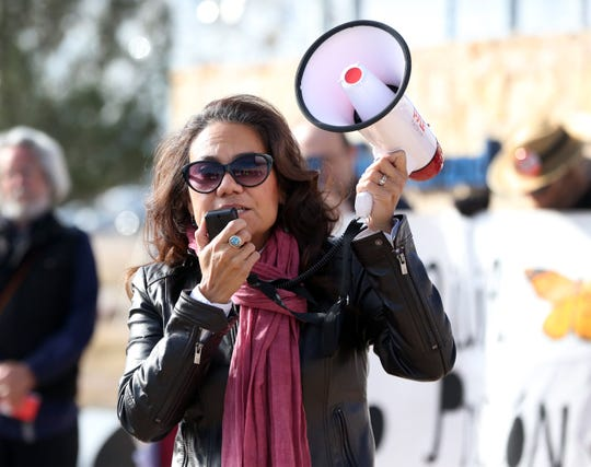 U.S. Rep. elect Veronica Escobar speaks to people who turned out for a Dec. 15 protest outside the Marcelino Serna international port of Entry in Tornillo, TX.