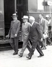 Federal Judge R.E. Thomason, President Harry Truman and Robert L. Holliday stride along briskly as the president prepared to board his train to continue his Texas tour after his El Paso speech in Sept. 25, 1948. They were followed by a Secret Service man. The railroad employee at the right stopped his work for a moment to get a good look at Truman.