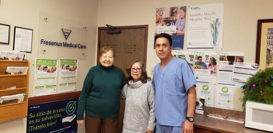 Cousins Maria Pacheco, left, and Elva Atilano stand with their nurse Rafael Hernandez at Fresenius Medical Care.
