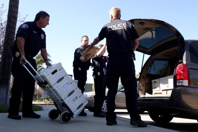 Investigators from the Ventura County District Attorney's Office load a van with boxes of evidence seized from Anterra's Santa Paula office in September 2014.
