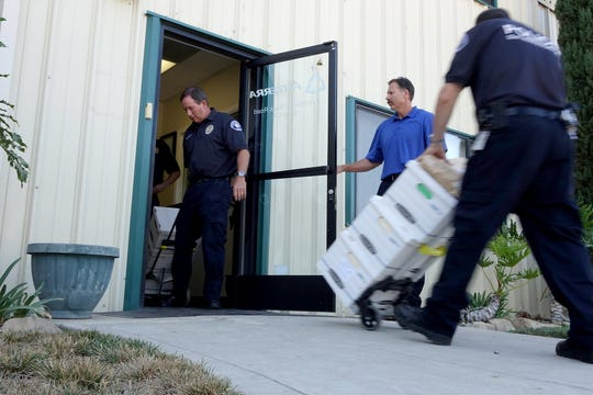 GRETCHEN WENNER/THE STAR Boxes of evidence were taken from Anterra's Santa Paula office by Ventura County  District Attorney's investigators n September 2014.
