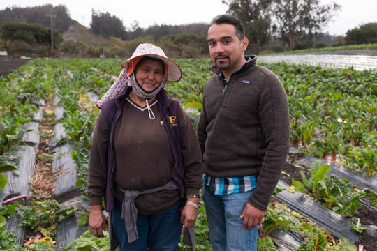 Farm owner Bertha Magaña and her adviser, David Mancera, pose at Magaña's farm in Prunedale.
