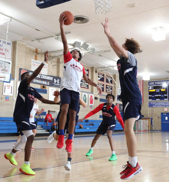 Stepinac's RJ Davis (1) puts up a layup during practice at Stepinac High School in White Plains on Wednesday, January 2, 2019.