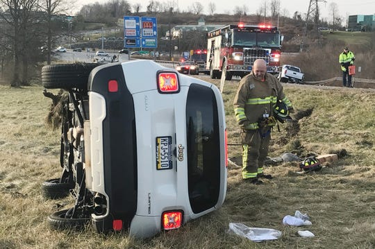 State police and Brewster firefighters work at the scene of a crash on the ramp from eastbound Interstate 84 to Route 312 at Exit 19 in Southeast on Jan. 2, 2019. The crash was apparently caused by a wrong-way driver.