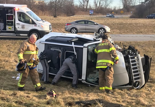 State police and Brewster firefighters work at the scene of an crash on the ramp from eastbound Interstate 84 to Route 312 for Exit 19 in Southeast on Jan. 2, 2019. The crash was apparently caused by a wrong-way driver. Three people had injuries that were not life-threatening.