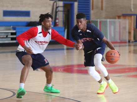 Stepinac's Alpha Bangura Jr. (23) drives to the basket against Malcolm Chimezie  during practice at Stepinac High School in White Plains on Wednesday, January 2, 2019.