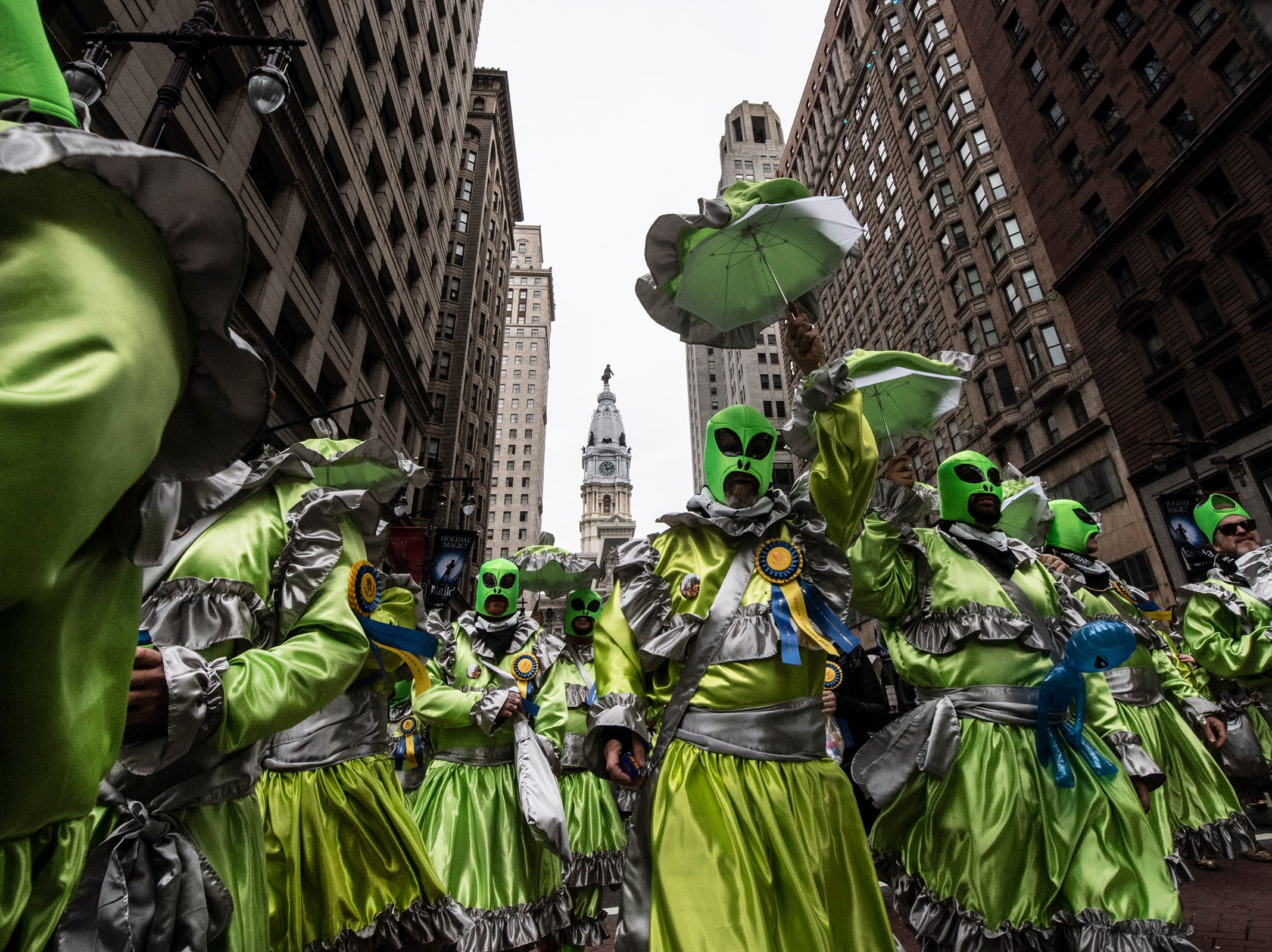 Members of the Murray Comics, the Mollywoppers, struts down Broad Street during the Mummers Parade, Tuesday, Jan. 1, 2019, in Philadelphia. (David Maialetti/The Philadelphia Inquirer via AP)