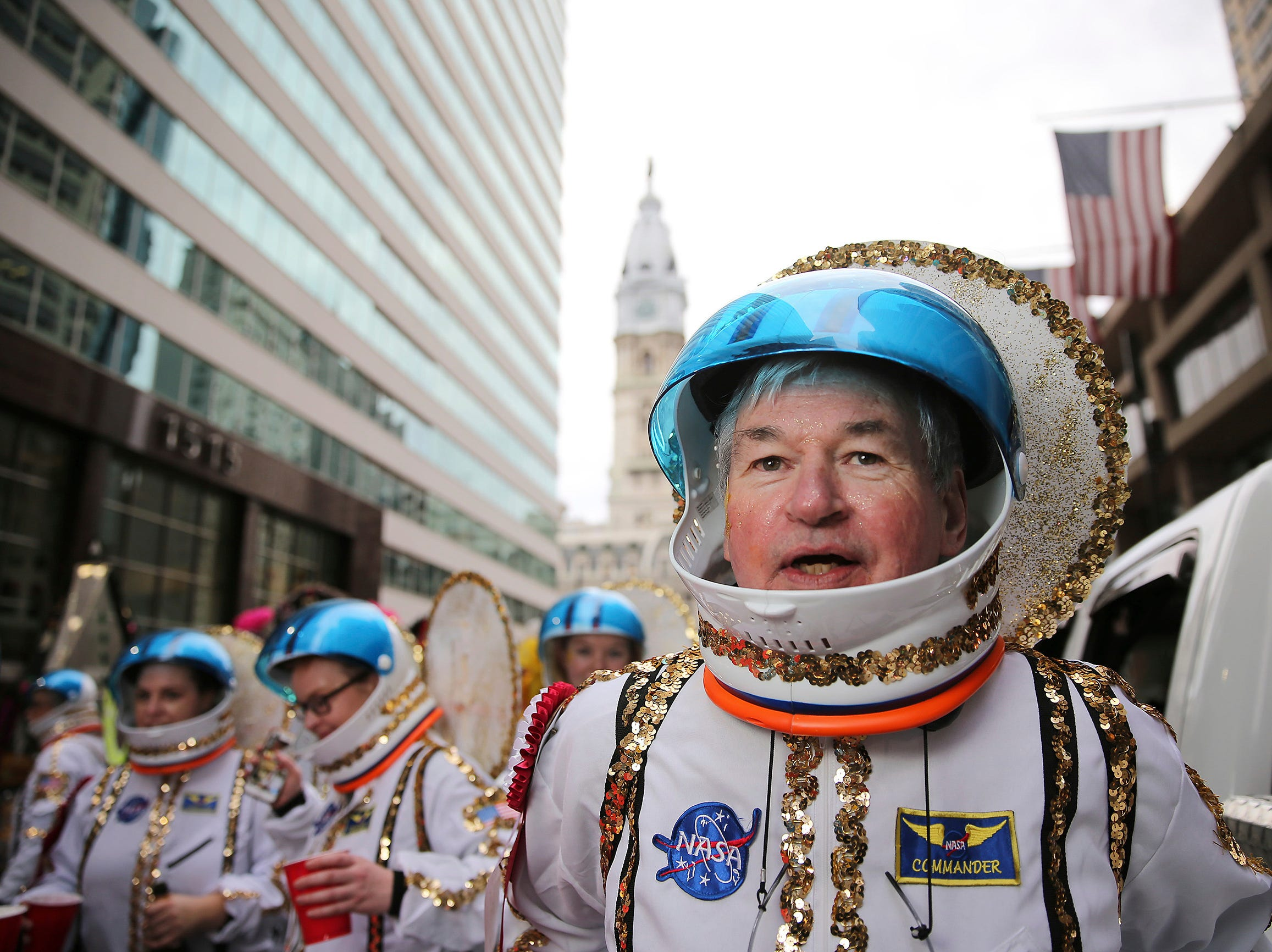 Harry Dougherty, of the Golden Sunrise Fancy Brigade, waits on the 1500 block of Market Street for the start of the Mummers Parade, Tuesday, Jan. 1, 2019, in Philadelphia. (David Maialetti/The Philadelphia Inquirer via AP)