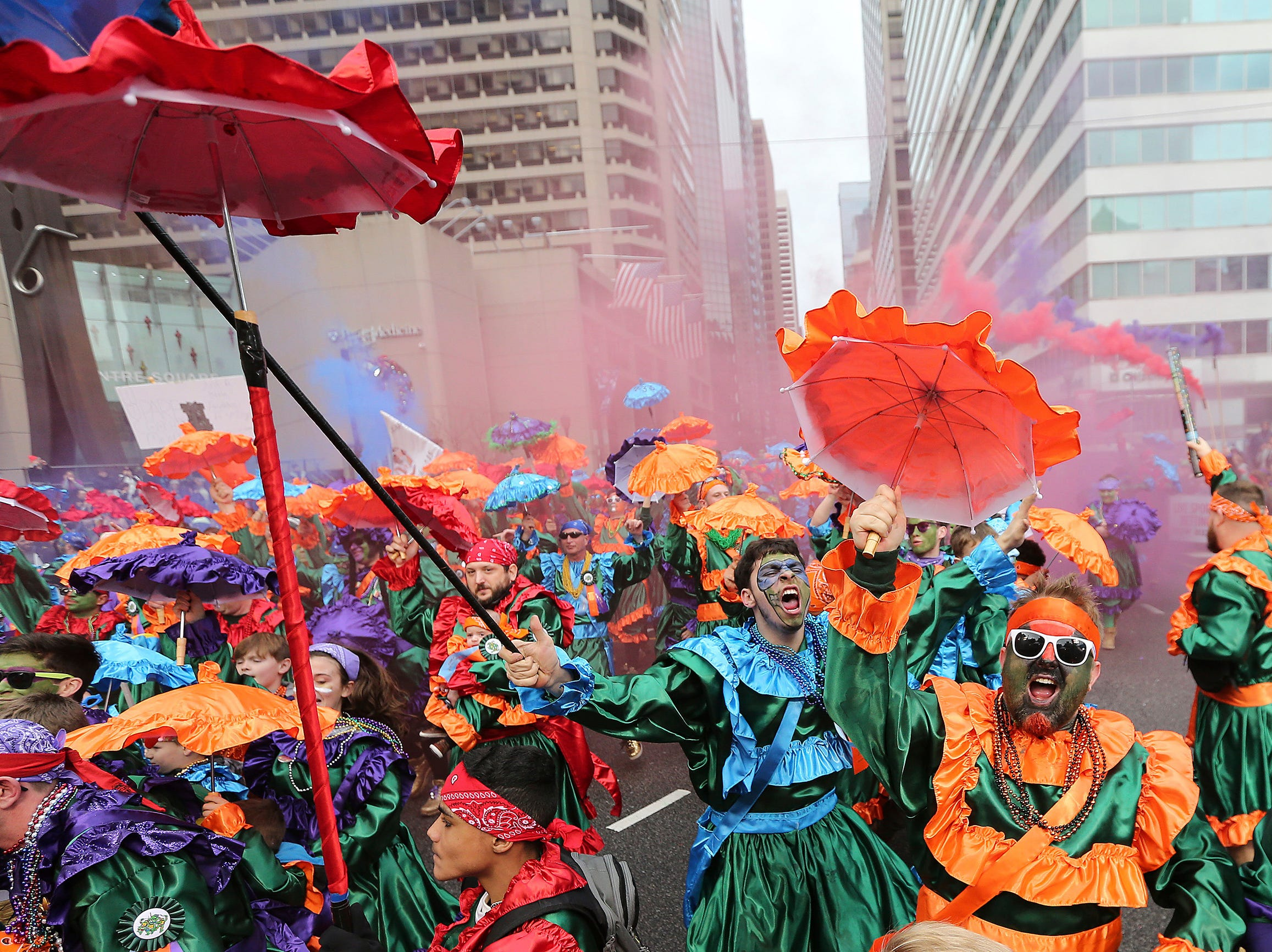 Members of the Saints Wench Brigade strut in front of the judges at City Hall during the Mummers Parade, Tuesday, Jan. 1, 2019, in Philadelphia. (David Maialetti/The Philadelphia Inquirer via AP)